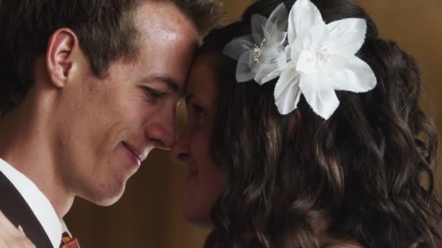 cu td bride and groom kissing / draper, utah, usa - groom stock videos and b-roll footage