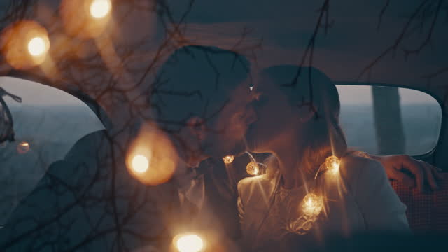 bride and groom kissing in car - stationary stock videos & royalty-free footage
