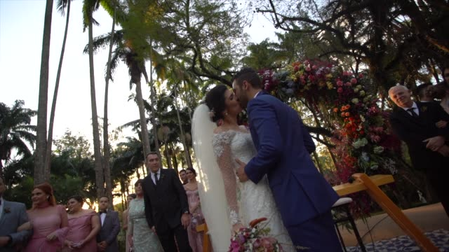 bride and groom kissing in the altar - christianity stock videos & royalty-free footage