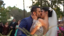 Bride and groom kissing in the altar
