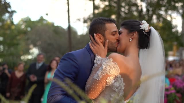 bride and groom kissing in the altar - kissing stock videos & royalty-free footage