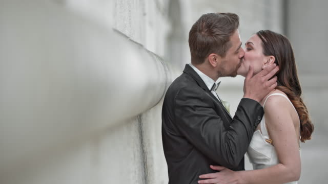 SLO MO Bride and groom kissing
