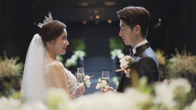 bride and groom standing face to face with a glass of champagne - korean ethnicity stock videos & royalty-free footage