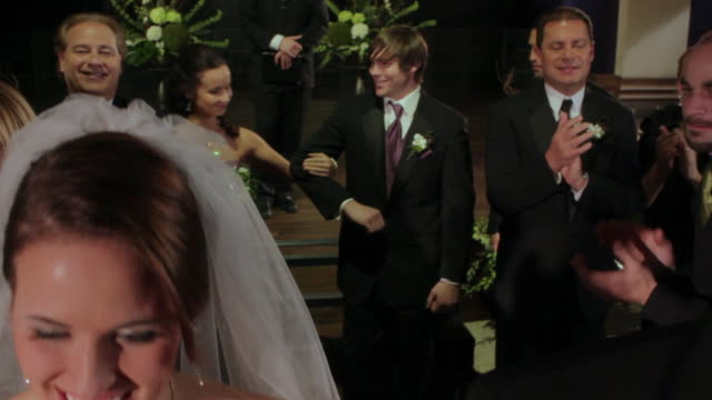 bride and groom walk up aisle followed by groomsmen and bridesmaids as guests clap - pastor stock videos & royalty-free footage