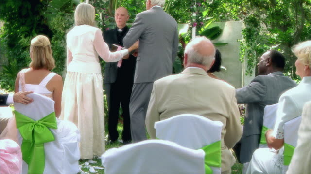 ws bride and groom walking down garden aisle to priest / tampa, florida, usa - guest stock videos & royalty-free footage