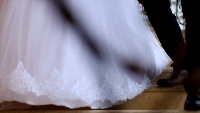 bride and groom walking down the stairs - bride stock videos & royalty-free footage