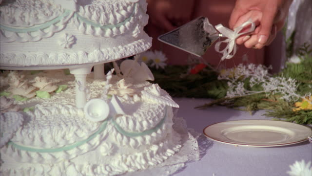 cu zo bride and groom's hands cutting wedding cake / unspecified - whipped food stock videos and b-roll footage