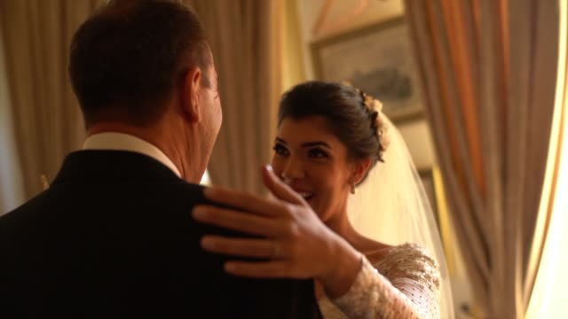 bride and her father on affection moments before wedding ceremony - father of the bride stock videos and b-roll footage