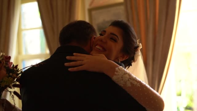 bride and her father on affection moments before wedding ceremony - christianity stock videos & royalty-free footage