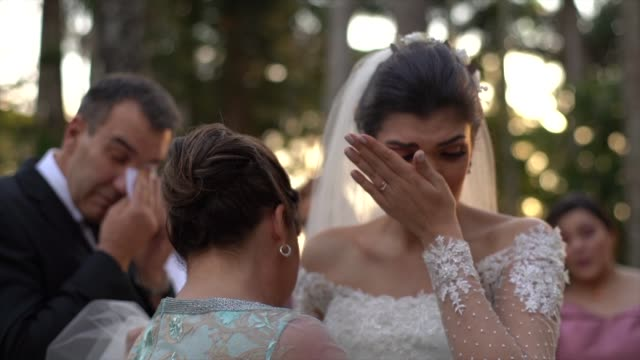 bride being congratulated by her parents at wedding ceremony - real people stock videos & royalty-free footage