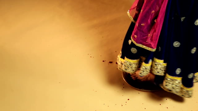 Bride entering home with her footprints on the floor, Delhi, India
