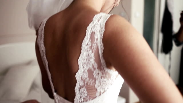 hd: bride getting dressed - bride stock videos and b-roll footage