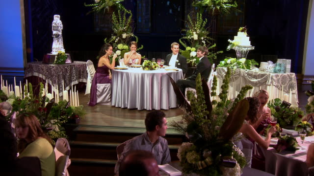 push in bride, groom, best man, and maid of honor laughing and talking at head table - best man stock videos and b-roll footage