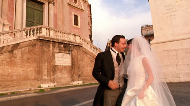 SHAKY bride + groom kissing in front of Trinita dei Monti / Rome, Italy