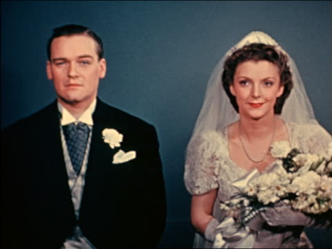 1941 bride + groom standing in marriage ceremony / industrial