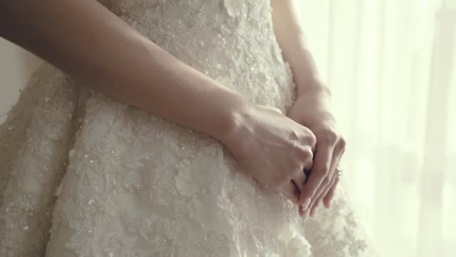 bride hand on white dress - wedding dress stock videos and b-roll footage