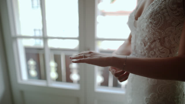 bride hands with wedding ring and bracelet on, near the window - bracelet stock videos and b-roll footage