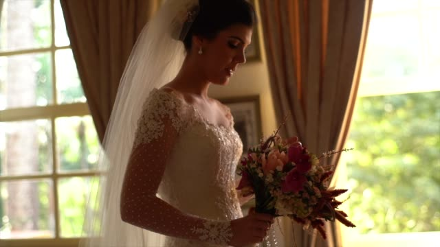 bride holding bouquet - christianity stock videos & royalty-free footage