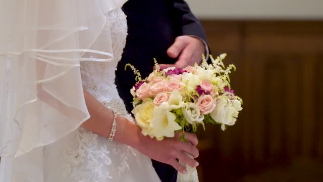 bride holding bouquet - bunch of flowers stock videos and b-roll footage