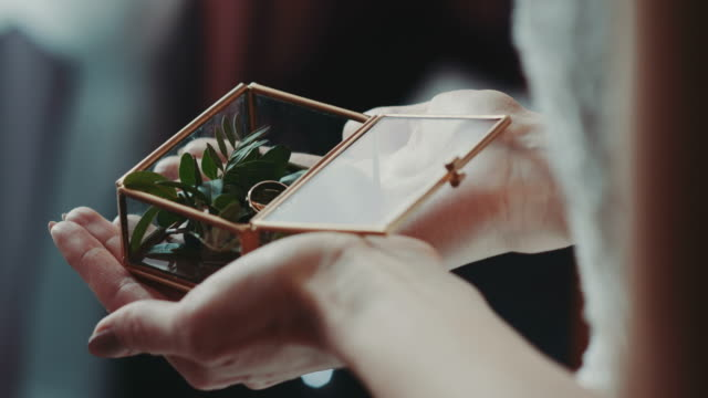 Bride Holding Engagement Ring Box