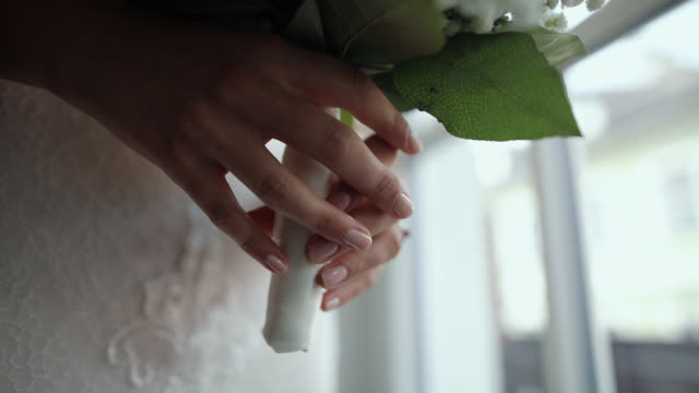 bride holding wedding bouquet in hotel room - bouquet stock videos & royalty-free footage