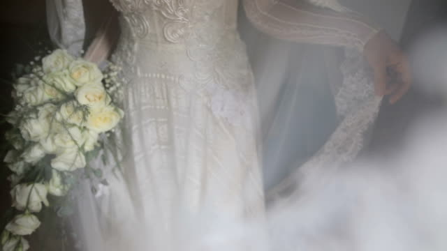 bride holding wedding bouquet - lace textile stock videos and b-roll footage