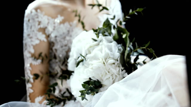 bride holding wedding bouquet while riding in a car - long stock videos & royalty-free footage