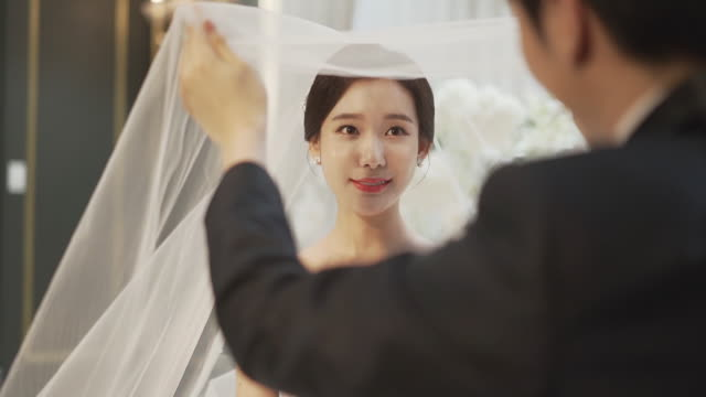 bride looking at groom in waiting room - wedding dress stock videos & royalty-free footage