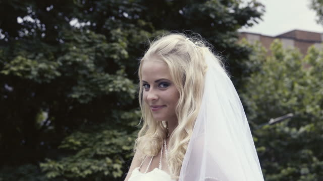 bride posing outdoors - bride stock videos and b-roll footage