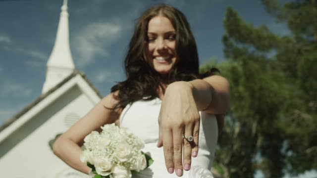 ms la bride presenting ring standing outside chapel / las vegas,nevada,usa - chapel stock videos & royalty-free footage