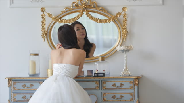 bride putting on earrings at a dressing table - drawer stock videos & royalty-free footage