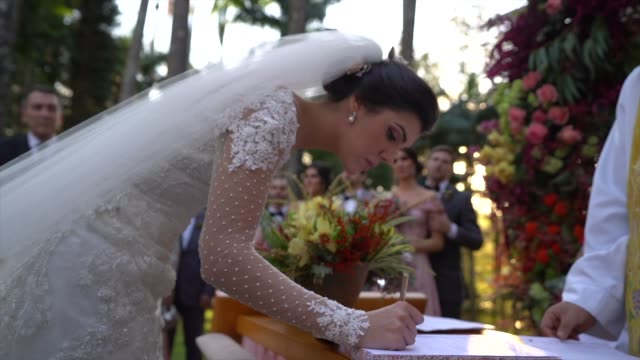 bride signing wedding book - christianity stock videos & royalty-free footage