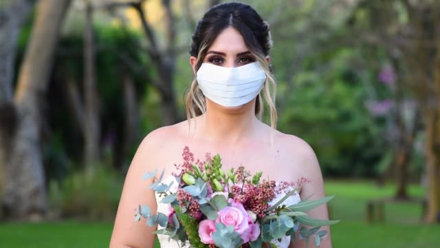 bride smiling behind the mask - wedding stock videos & royalty-free footage
