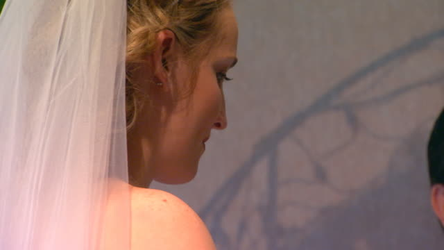 bride standing at altar, rear view - pastor stock videos & royalty-free footage