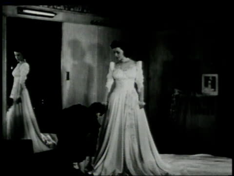 1946 ws bride standing in shop while seamstress is measuring and making alterations to the dress / new york, new york, united states  - dress stock videos & royalty-free footage