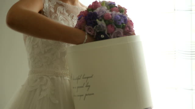 bride takes her biedermeier out of the box - earring stock videos & royalty-free footage