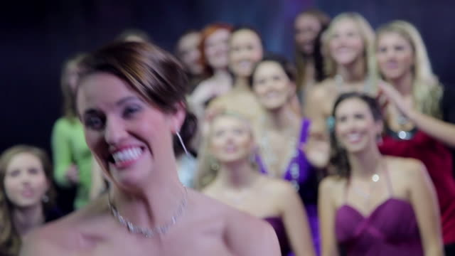 bride tosses bouquet over her shoulder to group of women and it's caught - blumenbouqet stock-videos und b-roll-filmmaterial
