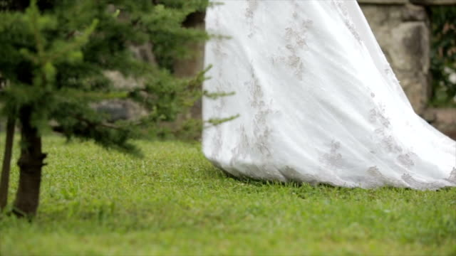bride walking in the garden - wedding dress stock videos and b-roll footage