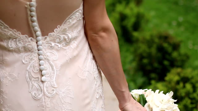 bride walking with bouquet in hand - copying stock videos & royalty-free footage
