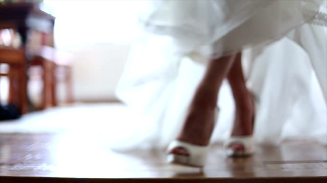 bride wearing wedding shoes - curve stock videos & royalty-free footage