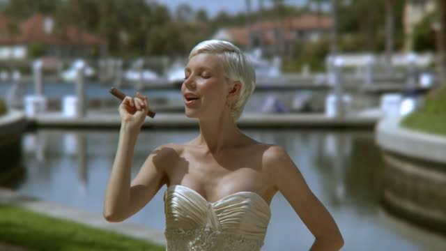 cu bride with cigar by pond, jacksonville, florida, usa - cigar stock videos and b-roll footage