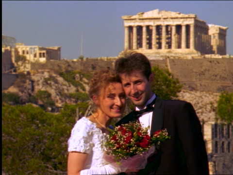 bride with flowers + groom posing + kissing in front of parthenon / athens, greece - bridegroom stock videos and b-roll footage
