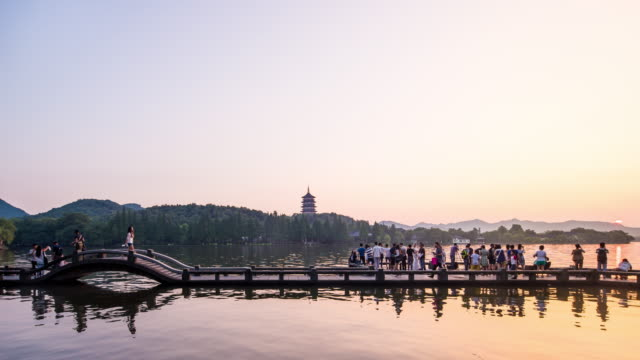 bridege and pagoda at the west lake of hangzhou from dusk to night.time lapse. - musical instrument bridge stock videos & royalty-free footage