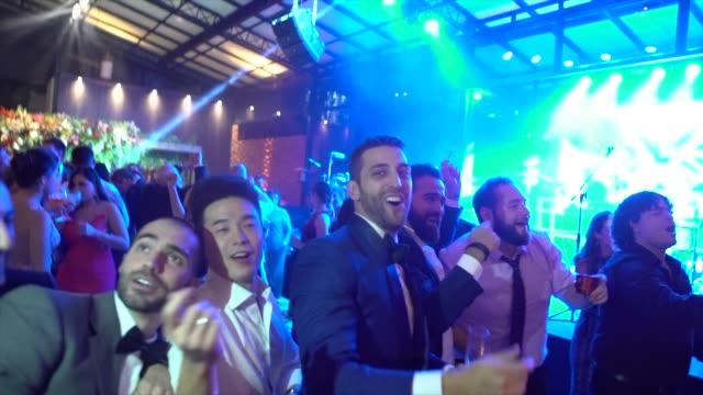 bridegroom dancing with wedding guests - wedding reception stock videos & royalty-free footage