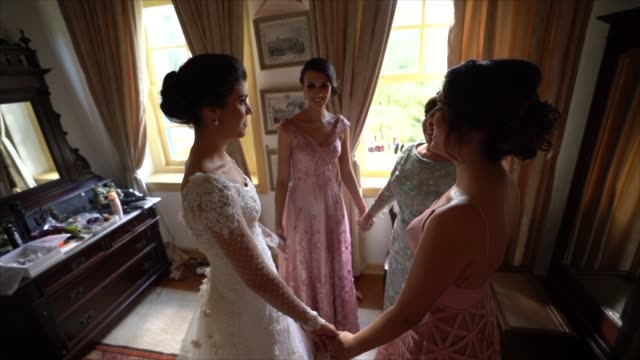 bridesmaids (sisters and mother) and bride praying before wedding ceremony - christianity stock videos & royalty-free footage
