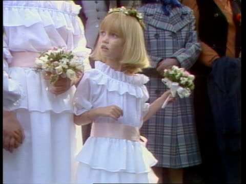 bridesmaids and pageboys st margarets zoom as clementine hambro out of soames wedding cms clementine rushes 4681 london tms catherine cameron along... - bridesmaid stock videos and b-roll footage