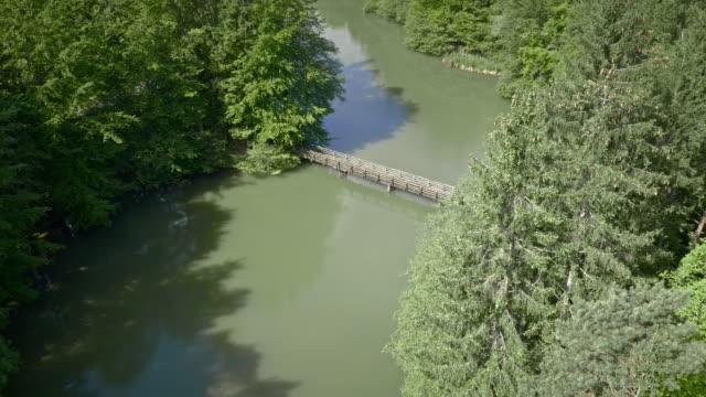 AERIAL Bridge across a lake in sunshine