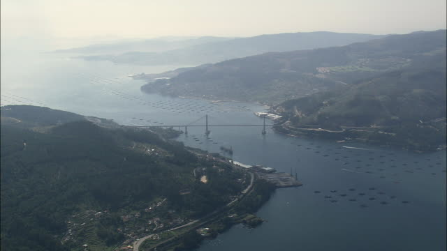 aerial ws bridge (puente de rande) across ria de vigo / vigo, galicia, spain - galicia stock videos & royalty-free footage