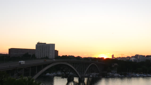 bridge and cityscape at sunset - arch bridge stock videos & royalty-free footage