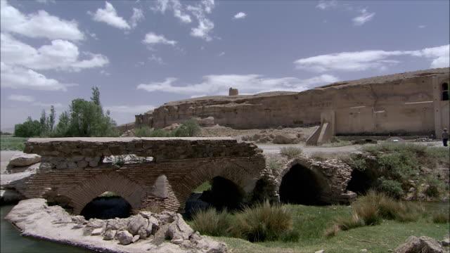 ws pan bridge and exterior of caravanserai, iran - inn stock videos & royalty-free footage